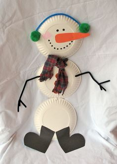 Snowman - paper plates, pom poms, pipe cleaners, construction paper, fabric, scissors, and sharpie - fun craft for kids