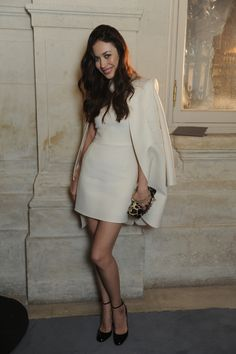 Olga Kurylenko wears a Valentino look from the Spring Summer 2014 collection to  the Valentino Spring Summer 2014 Haute Couture  Show as part of Paris Fashion Week on January 22nd 2014 in Paris