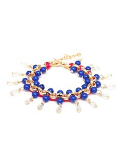 This striking bracelet works a subtle nautical vibe, with its glistening gold, deep blue beads and dangling white crystal fringe. The braided pink detail, meanwhiles, adds a pretty feminine touch.