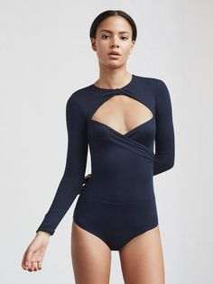 The Peoria Bodysuit is a long sleeve, eco bounce stretch jersey bodysuit that's got a cutout neckline with twist detail at the top.   https://www.thereformation.com/products/peoria-bodysuit-midnight?utm_source=pinterest&utm_medium=organic&utm_campaign=PinterestOwnedPins