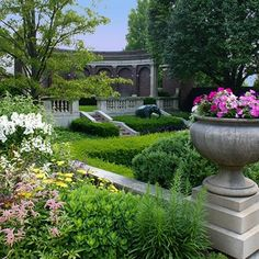 Irwin Gardens Columbus IN architecture.  A highlight of this two-acre property is the garden, a beautiful maze based on the Casa degli Innamorati in Pompeii. Several fountains and a long pool are the focal point of a lowered sunken garden