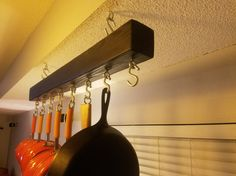 This ceiling mounted rack provides a clean and functional storage solution for your pots. With minimal space requirements, this rack works well in kitchens both large and small. Size: 3.5W x 3.5H x 36-46L (Wood) Includes: (8) S Hooks for Pots and Pans (2) 6 Chains for Lower Mounting (not shown) Mounting Hardware **Need a custom size, stain color or hook quantity/spacing? Just Ask! We can discuss what works best for your kitchen. (Price May Vary) Pot Racks are Made to Order. Shipment w...