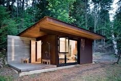 """This 191-square-foot cabin near Vancouver and its glass facades """"forces you to engage with the bigger landscape,"""" architect Tom Kundig says, but it seals up tight when its owner is away. The unfinished steel cladding slides over the windows, turning it into a protected bunker. Read the full story here."""