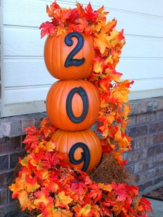 Decorate Your Porch for Fall Faux pumpkins are the perfect shape for stacking. Add a personal touch by adding your house numbers to this adorable topiary.