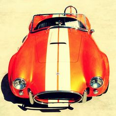 Shelby Cobra (1962-68).  I knew a guy who rebuilt a blue one.  I want one of these too