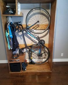 Top 70 Best Bike Storage Ideas - Bicycle Organization Designs From overhead to on the wall and beyond, discover the top 70 best bike storage ideas. Explore unique and creative bicycle organization designs. Bike Storage Cabinet, Bike Storage Home, Bicycle Storage Rack, Bike Storage Apartment, Outdoor Bike Storage, Bike Storage In Flat, Bike Storage For Small Spaces, Garage Storage, Bike Storage Solutions