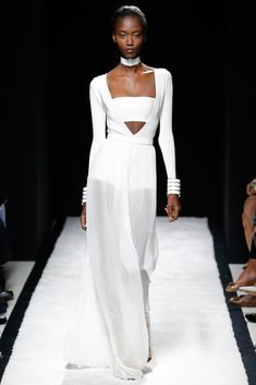 Spring 2015 Ready-to-Wear - Balmain  -- White bandeau under white low V-neck bodysuit with sheer white, pleated maxi shirt.