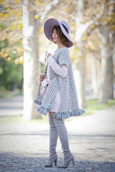 knitted poncho, over the knee boots outfit,