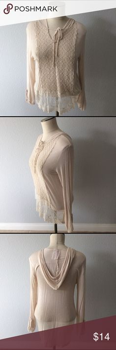 Anthropologie Lace panel hooded long sleeve Brand is Mauve by Anthropologie. Cream long sleeve shirt with lace insert. Size LARGE.  Shirt is in very good used condition the only issues is the cuff on one of the sleeves has come in-hemmed , however since the sleeves are buttoned and gathered up you can bit notice it. I had to smooth it out and make it noticeable for the picture.   Smoke free home Anthropologie Tops Tees - Long Sleeve