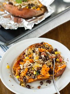 Loaded Southwestern Quinoa Sweet Potatoes - so much better for you than a regular baked potato and still filling. Stuff sweet potatoes with chicken, black beans, corn, quinoa, and more.