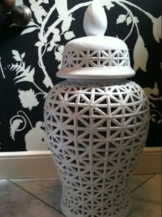 Kim Macumber Interiors - Great Way to Hide the Toilet Paper in a Powder Room
