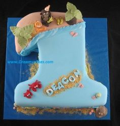 Today's cake is for a little boy's first birthday.A number 1 shaped cake with a beach theme. The cake is chocolate buttercake covered in chocolate but 1st Birthday Cakes, Boy First Birthday, Birthday Ideas, Beach Cakes, Cake Shapes, Cakes For Boys, Finding Nemo, Girl Cakes, Beach Party