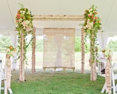 Another more substantial chuppah - love the screened burlap in the background!