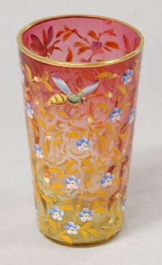 Moser amberina glass beaker in overall enamel of bees and flowers, circa 1885