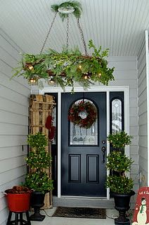 Beautiful yet very cheap wreath chandelier! pinned here to remember for front porch trees this spring.rcl