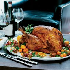 In this Thanksgiving recipe, the turkey is first brined and then marinated in citrus, garlic and annatto paste, which give the bird a beautiful orange sheen.