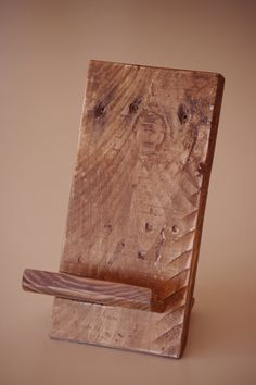 Wood Metamorphosis is presenting this unique handmade Phone Dock as another great mix of nature and craftsmanship.  This wooden phone stand