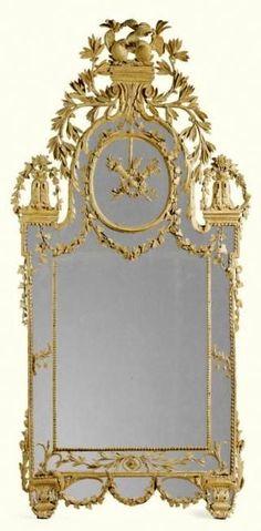 An Italian yellow painted carved mirror, Piedmontese, in the manner of Bonzanigo, late 18th century.