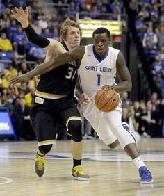 Saint Louis' Milik Yarbrough, right, heads to the basket as Wichita State guard Ron Baker defends during the second half of an NCAA college basketball game Saturday, Dec. 5, 2015, in St. Louis. Wichita State won 68-53. (AP Photo/Jeff Roberson)