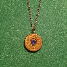 """12ga shotgun shell necklace with blue rhinestone 12ga shotgun shell necklace with blue rhinestone. 20"""" chain, silver chain gold shell. Hand made NWOT Jewelry Necklaces"""