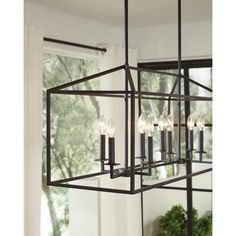The Sea Gull Lighting Perryton eight light kitchen island light in blacksmith…