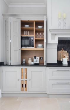 Hampshire: classic Kitchen by Lewis Alderson - example of appliances built in - like the tall units on the wall, like the contrasting wooden blocks/chopping boards