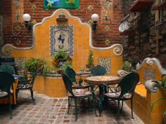 tile fountain built into wall. exactly what i want, different colors.. this is perfect for my backyard or a little coffee shop/internet cafe <3