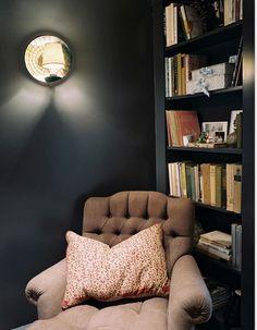 When you paint your shelves the same colour as your walls magic happens