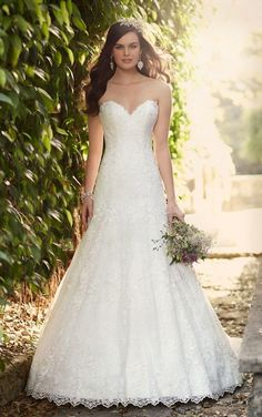 Embrace romantic details with this classic lace A-line bridal gown from the Essense of Australia wedding dress collection. It features a gorgeous sweetheart neckline, scalloped lace hem, and a classic chapel train. Choose from a corset closure or a zipper closure under crystal buttons.
