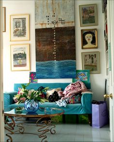 lulu guiness' home how did I know she would have a tuqouise couch ocean pictures circles and swirlys and the green boxes under the couch  not to mention the clutter and  flowers