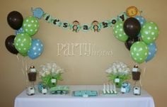"baby shower jungle theme.  On the flowers were color coordinating material and a cut out elephant, tiger, monkey etc.  Same as the banner acorss the top. The ""flowers"" are marshmellow babies as favours as well as three oreos dipped in chocolate dyed the theme colors. Decoracion Baby Shower Safari, Dulces Para Baby Shower, Cute Baby Shower Ideas, Monkey Baby Shower Decorations, Baby Shower Centerpieces, Baby Shower Themes, Baby Ideas, Baby Shower Gender Reveal, Jungle Theme"