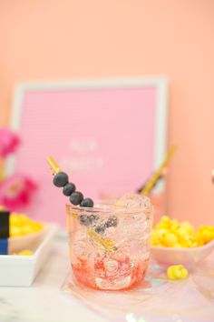 Fresh strawberries, vodka, berry-flavored sparkling water, simple syrup, blueberries
