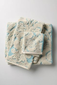 In Turquoise, Gold, or Neutral...they're so pretty.    http://www.anthropologie.com/anthro/catalog/productdetail.jsp?id=993101&catId=HOME-BATH&pushId=HOME-BATH&popId=HOME&navCount=12&color=070&isProduct=true&fromCategoryPage=true&isSubcategory=true&subCategoryId=HOME-BATH-TOWELS