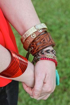 "My favorite Arm candy--> Green Market Girl Eco Cuff, Melvin Wood Bead Bracelet, Thunderbird Leather cuff by ""Rain Wheel"" via Etsy, Save the Planet & Peace Pono bangles, & a few friendship bracelets!"