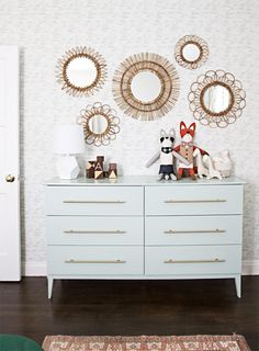 Believe it or not, this dresser is not vintage. Nor is it a high-end retail piece. Thanks to the ingenuity of Sarah Sherman Samuel over at Smitten Studio, a basic, no-frills IKEA staple was transformed into a sleek, beautiful, and functional feature.