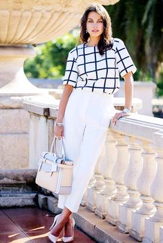 Annabelle Fleur of Viva Luxury wearing white trouser pants with a windowpane check shirt