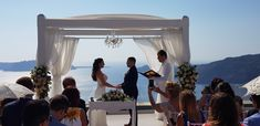 Taking their Vows Jennifer & Ian Le Ciel Santorini May 8th 2018 Wedding planners #simplymediterraneanweddings.co.uk