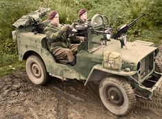 A jeep manned by Sergeant Albert 'Joe' Schofield (from Manchester) and Trooper Oliver Jeavons (from Hendon) of 1 SAS near Geilenkirchen in Germany. The Willys MB jeep is armed with three Vickers 'K' guns, and fitted with armoured glass shields in place of a windscreen. The SAS were involved at this time in clearing snipers in the 43rd Wessex Division area. 18th November 1944.