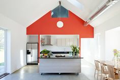 12 Kitchens with Color: The iconic shape and playful red color is carried from the Eastern exterior red gable through to the interior kitchen wall in the Passive House Retreat in Little Compton, RI, designed by Boston-based ZeroEngergy Design. Passive House, Kitchen Design, Energy Efficient Homes, Interior Inspiration, Portable Kitchen Island, Interior, House, Beautiful Kitchens, Home Decor