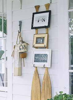 I like this idea from Better Homes and Gardens for a framed picture display.  This DIY is easy to do with just a couple of paddles and some wall hooks.