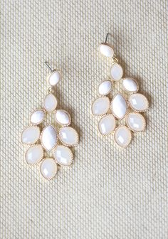 """For All Time Earrings 14.99 at shopruche.com. Clusters of faceted ivory and cloudy cream beads hang from these earrings creating a stunning and luminescent statement.2.5"""" long"""
