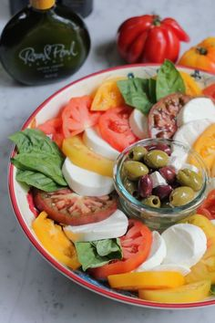 Simple caprese salad with fresh heirloom tomatoes and mozzarella
