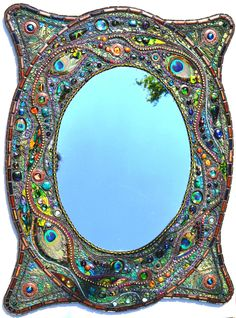 Mirror, hand made tiles, fused glass. peacock feathers, beads, glass, mother of pearl, gems, paint, by Nikki Ella Whitlock