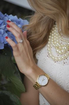 so much to love: pearls, diamond ring, red nails, blonde, hair and blue hydrangea