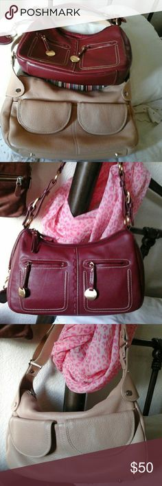 Maxx New york leather handbags Red and camel color leather hand bags great condition, the red one is intact the camel one needs to be clean ant the leather in the front part beautiful lining in both super clean no signs of wear just the camel one because of rime have a white spot. Needs leather cleaner. Maxx New york  Bags Shoulder Bags