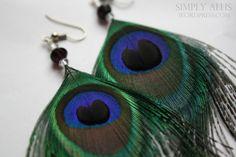 DIY peacock earrings!  http://simplyallis.wordpress.com/2011/12/22/peacock-feather-earrings-diy/