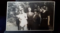 My uncle Dave's christening  1940 - At my uncle Dave's funeral today. The family pictures are are out and it's such a lovely way to remember him. This is his christening in 1940 probably Streatham  south London. Note the air raid shelter.
