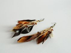 Autumn leaves leather earrings with glass beads. Statement long earrings. by vittrojewelry on Etsy https://www.etsy.com/listing/123558703/autumn-leaves-leather-earrings-with