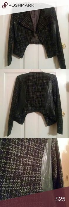 """Very J Jacket This jacket is black and green tweed with green faux leather paneling. The tweed features a slight shimmering thread throughout. The assymetrical zipper and hemline add an edgy vibe. It is 21"""" from shoulder to hemline and the sleeves are 25"""" long. Very J Jackets & Coats"""