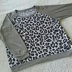 CLEARANCE - Leopard Sweatshirt Sz L Leopard Sweatshirt Sz L...super cute and comfy leopard print sweatshirt...removed tag and there's a small hole... not very noticeable at all when worn otherwise in excellent condition Boutique Tops Sweatshirts & Hoodies